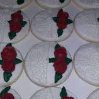 Sweet Lace These cookies are half covered in icing lace and the other half has simple but elegant roses on them. They're perfect for weddings....