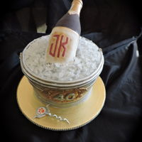 Wine Lover The wine bottle is made from cereal treat and fondant and decorated with the recipient's initials and birth year. Bucket was aged with...