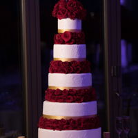 5 Tier Wedding Cake In White, Gold And Red Roses This was a 5 tier red velvet wedding cake - a simple classic design separated by real red roses, a customized leaf stencil and a gold...