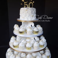 "50Th Anniversary Cupcake Tower For some reason, this simple cupcake tower has been saved upwards of 4,000 times on Pinterest. Handmade gumpaste ""50"", fondant..."