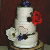 Birch Wedding Cake White rustic texture buttercream floral accents and a heart topper.