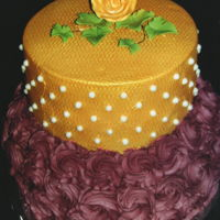 Burgundy And Gold Birthday Bottom tier is decorated with burgundy rose swirls. Top tier is covered with gold buttercream and decorated with white pearls and topped...