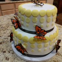 Butterfly Polkadot Cake Two tiers covered in fondant. Lemon cake with lemon curd buttercream and strawberry buttercream. Chocolate butterflies.