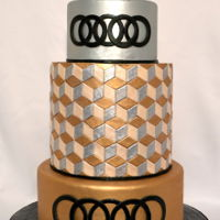 Geometric Metallic Optical Illusion wedding white cake, covered in fondant with fondant accents. Hand painted gold, silver, and champagne colors. Champagne painted gumpaste...