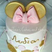 Gold Minnie Mouse Pink pastel bow and golden ears of minnie mouse!! edible gliter gold on an elegant victoria sponge cake filled with chocolate and...