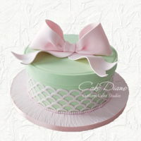 Hatbox Baby Shower Cake Hatbox style cake with scalloped lattice onlay and big pink fondant bow