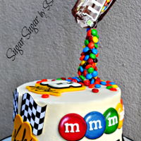 Kyle Busch Nascar Birthday Cake This is a chocolate and vanilla checkerboard cake covered in buttercream, decorated with fondant and M & M's. All decoratipos are...