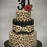 Leopard Print Birthday There is just something about animal prints - they are elegant, fun and bold. This 30th birthday cake is complete with hand-painted leopard...