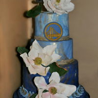 Magnolia Birthday Cake One tier chocolate, second tier strawberry and third tier vanilla-almond, filled and frosted in buttercream, covered in LMF. Magnolias made...