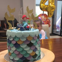"Mermaid Cake 2 x ( 7"" x 3"") white mud cakes.filled with colored white ganache. Covered with milk choc ganache.Covered in fondant..."