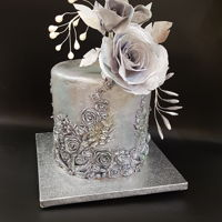 Metalica Cake With Wafer Rose I made this silver-metal bas relief cake for my birthday.