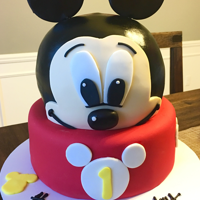 Mickey Cake I carved the head from marble cake with swiss buttercream