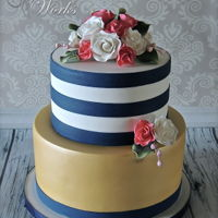 Navy And White Stripes Navy and white stripes in fondant. The bottom tier is airbrushed metallic gold. The flowers are gumpaste.
