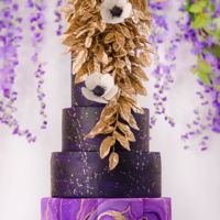 Pantone Ultraviolet Wedding A recent wedding cake inspired by the new Pantone ultraviolet trend, with a cascading bouquet of gold sugar-leaves and sugar anemones.