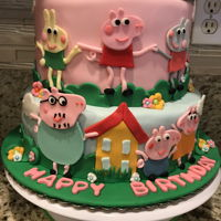 Peppa Pig Birthday Cake Two tier peppa pig fondant covered cake.