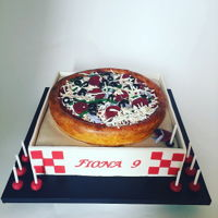 Pizza Cake Pizzza cake in a box, featuring modeling chocolate box panels, square base cake with circle cake layer on top, covered in all fondant and...