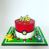 Pokemon Cake With Pikachu And Froakie (And Tons Of Pokeballs) Pokemon cake featuring Pikachu and Froakie figures and pokeballs. All details fondant.