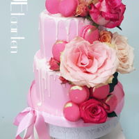 Pretty In Pink Drip Real gorgeous roseson a pink drip cake with macarons