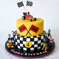 Race Car Mickey Mouse Birthday Cake This design was sent to me by my client, so I don't know who to give credit to, but it made for a cute cake. The Mickey Mouse family...