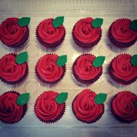 Red Rose Cupcakes Carrot cupcakes with cream cheese frosting and fondant leaves.