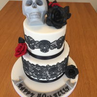 Skull And Rose Birthday Cake A different type of cake design for me! Suited my sister in law totally. Coconut and raspberry and regular vanilla cakes. Gumpaste flowers...