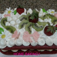 Strawberry & Kiwi red velvet cake decorated with cream cheese frosting, strawberries and kiwi
