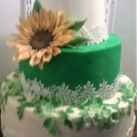 Sunflower Cake Gumpaste sunflower wedding cake with sugarlace and fondant lace pieces.