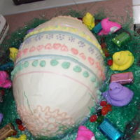 Sweet Easter Egg Cake White cake filled with strawberry filling. Buttercream Icing.