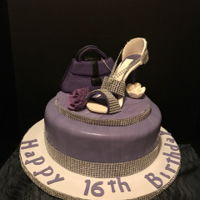 Sweet Sixteen Theme Cake Sweet Sixteen Theme Cake vanilla flavored filled with raspberry flavored frosting. Shoe and purse were made out of gumpaste...