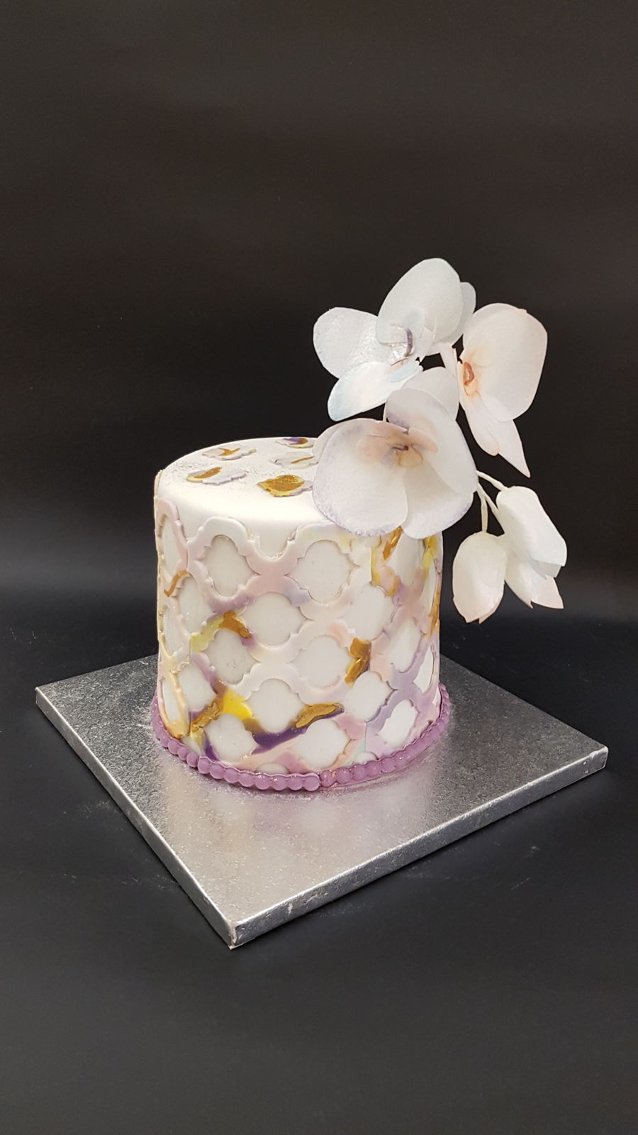 Marbeled Cake With Wafer Orchids on Cake Central