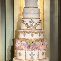 8 Tiers Wedding Cake With Gold And Silver Decorations Only bottom tier is real, cake size start with 16, 14, 12, 10, 8, 6 & 4. Real flowers