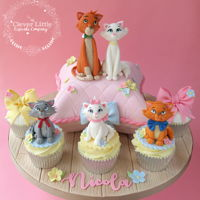 Aristocats Cake With matching cupcakes.