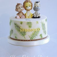 Baby Animals Cake Baby animals cake for a baby boy with handpainted leaves.