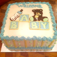 Baby Shower Cake Double layer chocolate cake filled, frosted and decorated with buttercream frosting. Made this for a co-worker's baby shower. TFL!
