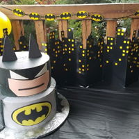 Batman Batman cake, frosted in Pastry pride, and air brushed, face mask out of Fondant