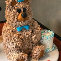 Bear Cake This bear cake is for a one year old so it includes the smash cake, it has two tiers of cake and the head and arms are made out of rice...