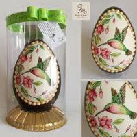 Bird Easter Egg Easter egg in chocolate covered with oval in sugar paste with bird and hand painted flower shoots