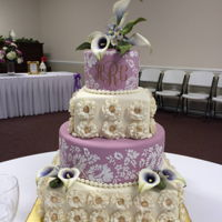 Calla Lily Wedding The square tiers are covered in gold accented rosettes with a gold button all made of fondant. Calla lilies are gumpaste. The bride wanted...