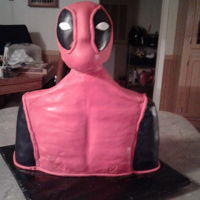 Deadpool 3D RKT head and the rest is cake covered in fondant.