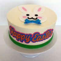 Easter Bunny Cake Easter cake with simple flat bunny topper and Happy Easter plaque, both cut with my Cricut.