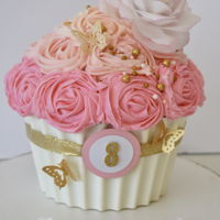 Girly Rose And Butterfly Cupcake Cake Giant cupcake cake with white chocolate shell and wafer paper rose and gold butterflies.