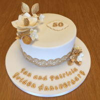 Golden Anniversary Cake Cake for my friends lovely parents - fruit cake. Sugar flowers and cake lace coloured gold using sugarflair autumn brown.