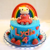 Hello Kitty Cake Lydia's Hello Kitty cake! A 6 inch blue french vanilla cake, all buttercream and candy clay details for this adorable little girl! All...
