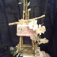 Orchids And Bamboo Bridal Shower Cake This is a bridal shower cake for a friend's daughter. Her colors were pale green and pink. I did add additional orchids up to the buds...