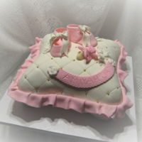 Precious Pink Baby Girl So glad I got to try my new pans for this cake. Love how it turned out! All edible, fondant shoes and pacifier.