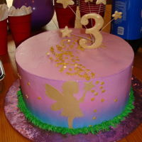 Purple Fairy Cake For My niece she wanted, Purple and Fairies, I tinted the cake batter a light purple, and used a huckleberry filling, the cake is iced in...