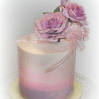 "Purple Roses 6"" chocolate cake with white chocolate buttercream, topped with gum paste roses."