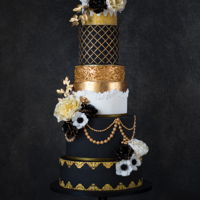 Romantic Great Gatsby Romantic Great Gatsby themed wedding cake. The inspiration of the cake was the wedding dress. Love the glitz & glamour of this cake.