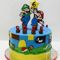 Super Mario Bros cakeiced with buttercream and mmf and gum paste decorations