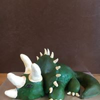 Triceratops Cake Cotton candy cake with cotton candy buttercream covered in modeling chocolate